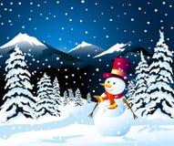 Snögubbe och vinterlandskap Arkivfoto