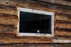 Snögubbe på fönstret royaltyfria foton