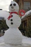 Snögubbe på ingången till det Santa Claus kontoret i Lapland Arkivbild