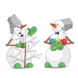 Snögubbear som dekorerar julgranen Royaltyfria Foton