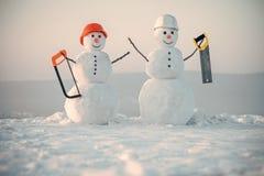 Snögubbebyggmästare Lycklig ferie och beröm arkivbilder