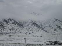 snöig berg Arkivfoton