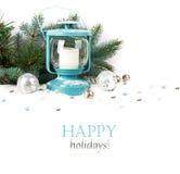 Snöig blå lykta och julbollar Fotografering för Bildbyråer
