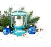 Snöig blå lykta och julbollar Royaltyfri Fotografi
