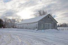Snöig ladugård Arkivbild