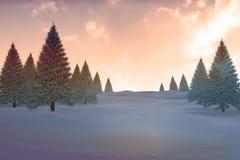 Snöig landskap med granträd Arkivfoto