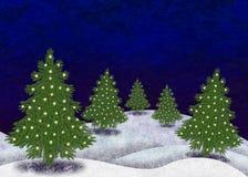 Snöig landskap med julträd Arkivbild