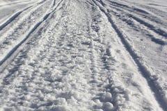Snöig landsvägar för textur Royaltyfri Fotografi