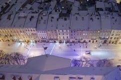 Snöig panorama av Lvov på julafton Royaltyfria Foton