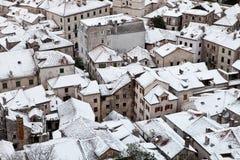 snöig rooftops Arkivbild