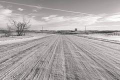 Snöig tillbaka vägar arkivfoto