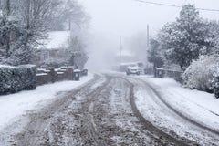 Snöig väg för lantlig by Royaltyfria Bilder