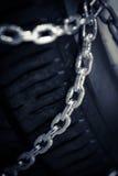 Snökedjor på gummihjulet Fotografering för Bildbyråer