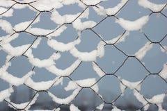 Snön på försåg med en hulling inget - tråd Royaltyfria Foton