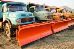 Snöploglastbilar Arkivbild