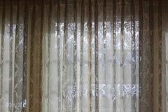 Snöra åt gardinen arkivfoto