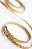 Snöra åt guld- läder Royaltyfria Bilder