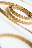 Snöra åt guld- läder Royaltyfri Bild
