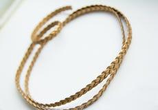 Snöra åt guld- läder Royaltyfria Foton