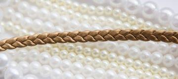 Snöra åt guld- läder Fotografering för Bildbyråer
