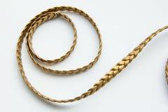 Snöra åt guld- läder Arkivbild