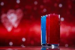 Snöslaskis i exponeringsglas, rött och blått blänker på stjärnan arkivfoto