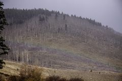 Snöstormregnbåge på 10000 fot Arkivbilder