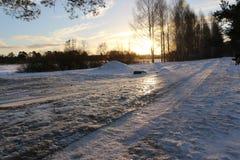 Snöväg och solnedgång Fotografering för Bildbyråer