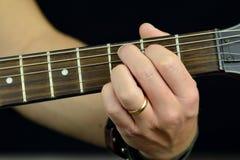 Snaar op de gitaar Stock Fotografie