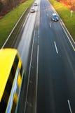 snabb väg för bilkörning Arkivfoto