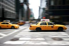 Snabba taxiar Fotografering för Bildbyråer