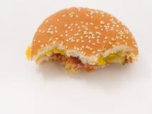 Snabbmat biten hamburgare på vit bakgrund royaltyfri foto