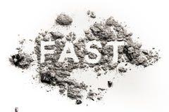 Snabbt ord som är skriftligt i aska, damm eller sand arkivfoton