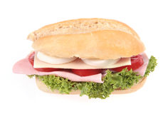 Snack. French bread filled with ham, cheese, eggs, salad Royalty Free Stock Images