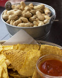 Snack. A tasty snack with peanuts nachos and salsa royalty free stock photo