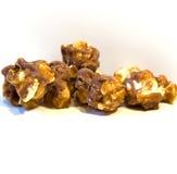 Snack. Chocolate, caramel popcorn, isolated on white Royalty Free Stock Image