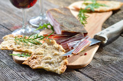 Snack with bacon. Snack with delicious South Tyrolean smoked bacon with crispy rye flat bread Stock Image