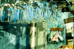 Snack bar. Clean glasses hanging in a bar of a retro cafeteria Royalty Free Stock Photography