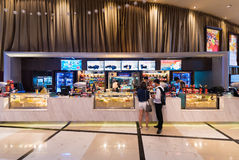 Snack bar. BANGKOK - MARCH 17, 2016 : Unidentified people buy food at a snack bar of Paragon Cineplex in the Siam Paragon shopping mall. With 16 screens and 5 Royalty Free Stock Images