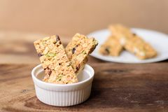 Snack bar or energy bar in a bowl. And dish on wooden background, healthy food Royalty Free Stock Photo
