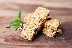 Snack bar or energy bar. On wooden background, healthy eating Stock Photo