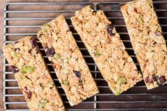 Snack bar or energy bar. On cooking rack, top view of food Stock Images