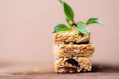Snack bar or energy bar. Stack of snack bar or energy bar on wooden background Stock Image