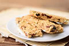 Snack bar or energy bar. On white dish, healthy food Stock Photography