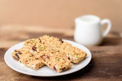 Snack bar or energy bar. On white dish, healthy food Royalty Free Stock Image