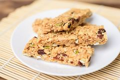 Snack bar or energy bar. On white dish, healthy food Stock Image