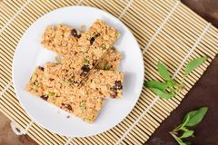 Snack bar or energy bar. On white dish, top view Royalty Free Stock Image