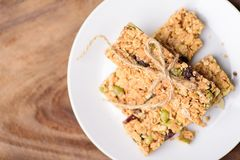 Snack bar or energy bar. On white dish, top view of food Royalty Free Stock Images