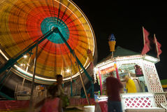 Snack Bar and Ferris Wheel. People stand in line at a Carnival Snack bar Royalty Free Stock Image