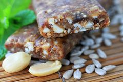 Cereal bars. Delicious fruity nutty snack bar sitting on the table Royalty Free Stock Photos